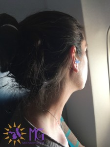 woman wearing Earplanes on flight