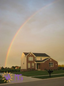 house with a rainbow over it