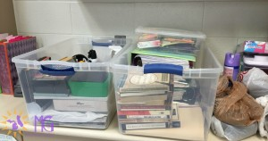 clear plastic tubs of teacher items