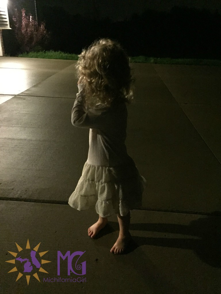 toddler bare foot in the driveway