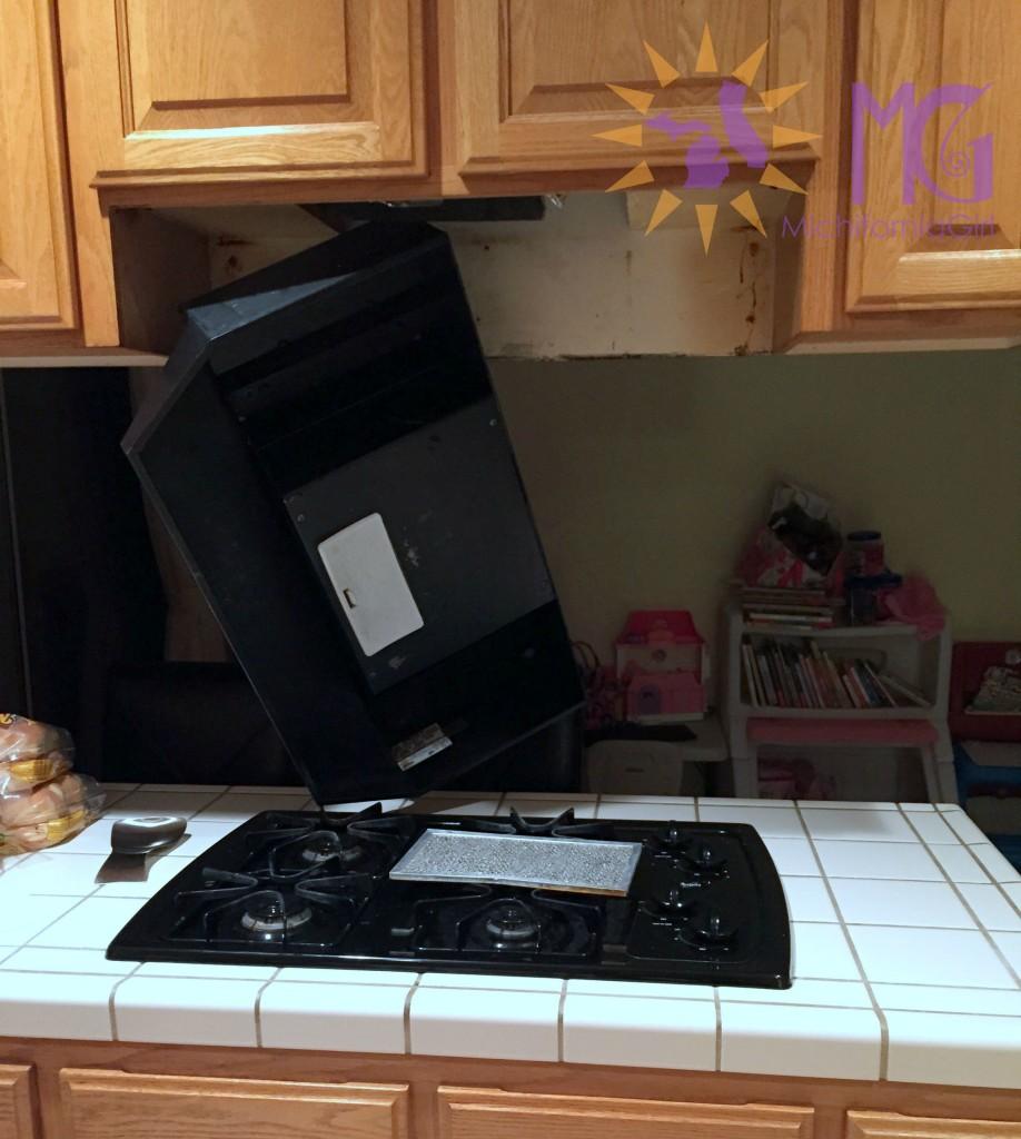things fall apart: broken hanging stove vent hood