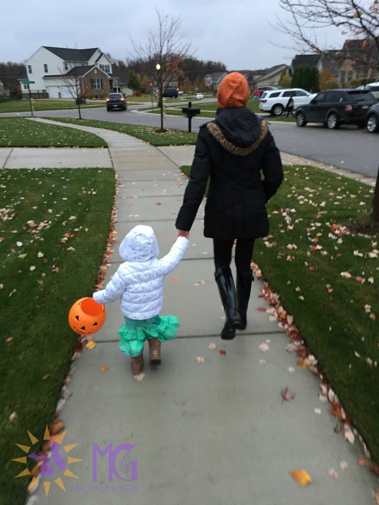 mom and toddler trick-or-treating