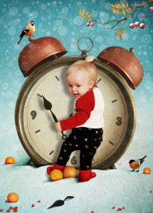 baby standing in front of large alarm clock