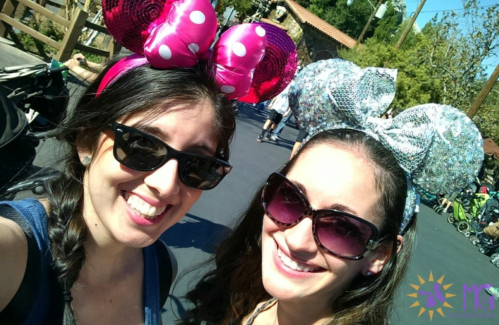 two women with minnie mouse ears at disneyland