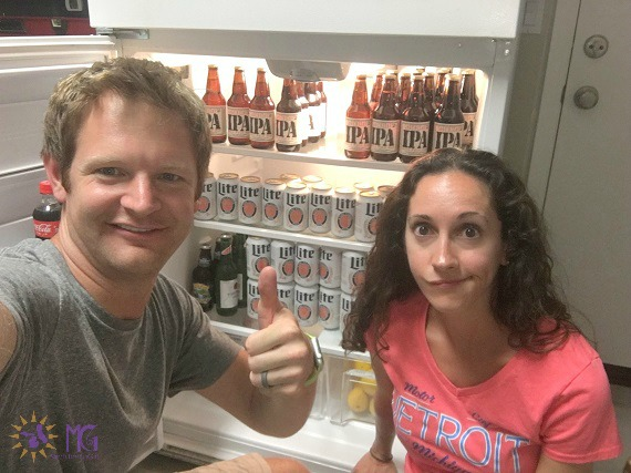 """Day 3 of the Love Your Spouse Challenge: Can a sister get a little space for some vino? Nah? WAIT. Maybe I can wedge something in the slot between those IPAs. Today I nominate anyone whose spouse throws the """"thumbs-up"""" sign every time they take a selfie."""