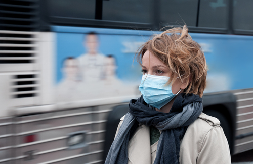 woman wearing surgical mask in public silicon valley